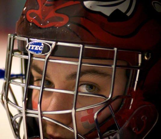 Adult beginner hockey player